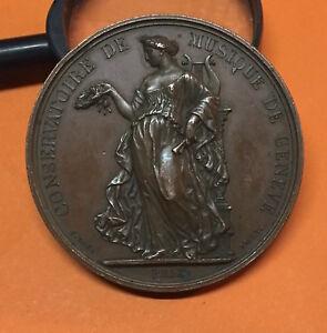 CONSERVATOIRE de MUSIQUE de GENEVE 1860 ( SUISSE ) MEDAILLE CUIVRE signé : BOVY.