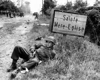 US Soldier at St. Mere-Eglise Sign during  D-Day 8x10 WWII WW2 Photo 902
