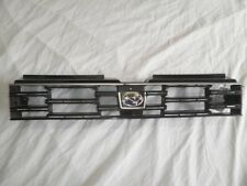 Subaru L Series 85-87 - Grill. Black. Good condition. With badge.