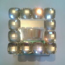Tea light holder with jewelled frame