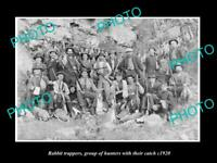OLD POSTCARD SIZE PHOTO OF RABBIT TRAPPERS HUNTING TEAM WITH THEIR CATCH c1920