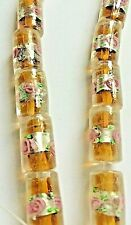 Amber Coloured Silver Foil Glass Cylinder Shaped Beads. Size 17x10x10mm.