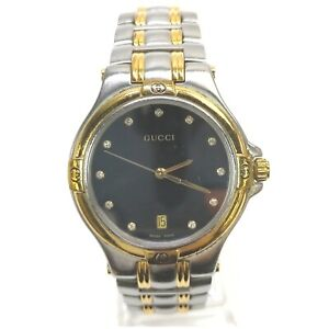 Gucci Watch  9040M operates normally 1903691
