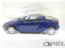 Eso-2892 HERPA 1:87 Opel tigra bleu très bon état, avec emballage d'origine,