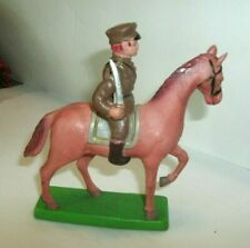 VINTAGE LARGE CELLULOID TOY SOLDIER ON HIS HORSE, STRING ARMS, JAPAN