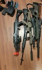 used airsoft gun lot batteries, mags, bbs, attachments
