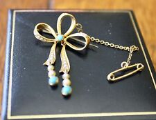 15ct yellow gold bow brooch studded with turquoises and pearls