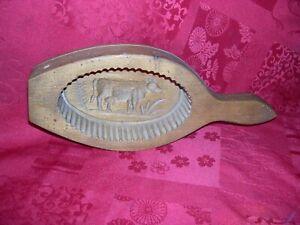 ancien moule à beurre en bois objet d'art populaire décor de vache