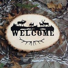 Wood deer and elk welcome sign