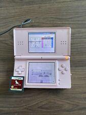 Nintendo DS Lite rosa con cargo leve daño a la pantalla