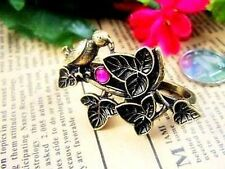 Vintage style bronze bird on a branch double finger ring