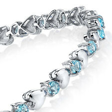 925 Sterling Silver Aquamarine Heart Shaped Cubic Zirconia Puff Tennis Bracelet