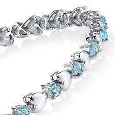 925 Sterling Silver Aquamarine Heart Shaped Cubic Zirconia Puff Tennis Bracelet