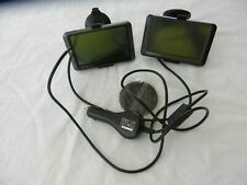 Two Garmin 205W Series Navigation Devices with Cord and Guide