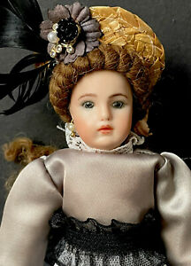 """Reproduction of Antique 8"""" Miniature Doll Porcelain Head Leather Body"""