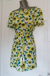FABULOUS.....SIZE UK 16-18.....WHITE & BOLD FLORAL SUMMER PLAY-SUIT....LOOK....