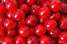 Set de 50 perles en bois naturel diamètre 25 mm. en couleur rouge