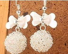 Silver tone iron wire ball and bow dangle earrings