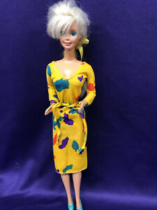BARBIE DOLL WEARING BARBIE DESIGNED YELLOW DRESS W/MULTI-COLORED PATTERNS. (151)