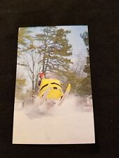Old Yellow Snow Mobile in Mid Air - Old Postcard Unused 126577