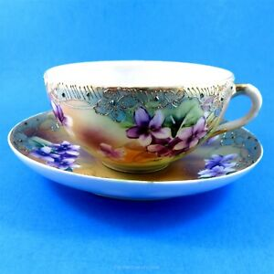 Hand Painted Violets with Raised Gold Border Nippon? Tea Cup and Saucer