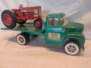 Vintage Ertl International Harvester Loadstar Tilt-Back Flatbed Truck w/Tractor