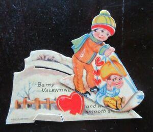 Vintage GERMAN-MADE Die Cut MECHANICAL Valentine's Card CHILDREN SLEDDING ON HIL