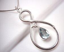 Faceted Blue Topaz Pendant Sterling Silver Infinity Hoop is Everlasting Love