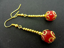 A PAIR OF DANGLY RED JADE  BEAD GOLD PLATED DROP EARRINGS.