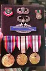 8 Military Pins in Display Case:Rifle,Airborne,Desert Storm & more