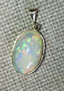 9cts Natural solid crystal rainbow fire Opal 9ct yellow gold pendant no necklace