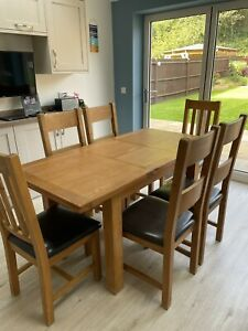 Solid Wood Extending Dining Table With 6 Chairs.