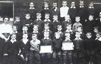 Vintage social history rp postcard of a group of school boys one very miserable