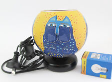 Blue Cat on Yellow Glowing Glass Electric Lamp