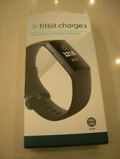 Fit Bit Charge 3 Advance Fitness Tracker with the Charger.  Works .  Black band