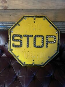 Antique Embossed Metal Stop Sign Yellow Thru Street W/Glass Cat Eye Marbles NICE