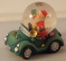 Santa in green car Christmas waterball 6cm x 7.25cm