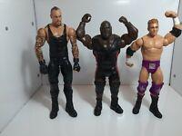 2011 Mattel WWE Wrestling Figures Joblot X 3 including The Undertaker.