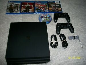 PS4 Pro Sony PlayStation 4 Pro 1TB with 5 GAMES 2 CONTROLLERS BUNDLE RES.EVIL 3