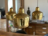 Alvar Aalto. Golden Bell Chandelier manufactured by Louis Poulsen.