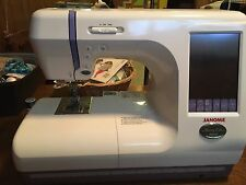 Janome Memory Craft 10000 Computerized Sewing and Embroidery Machine
