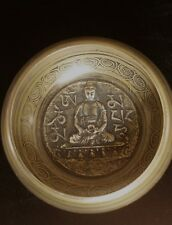 Tibetan singing bowl with Buddha  etched inside.5 inch curved sided with beater