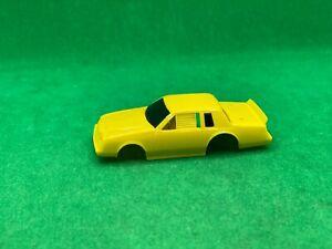 ORIGINAL TYCO GM BUICK STOCK CAR BODY, WRANGLER TEST SHOT, YELLOW, NEW UNUSED