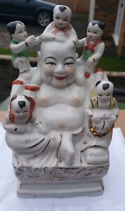 20th century Chinese porcelain figures of the happy Buddha