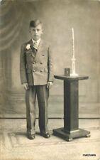 1938 Interior Young man in suit Religious items Photo Studio RPPC postcard 10262