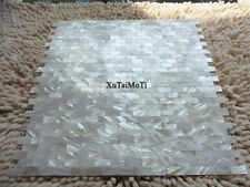 white groutless shell mosaic mother of pearl kitchen backsplash brick wall tile