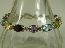 BRACELET:  MAGNIFICENT QUALITY OVAL CUT (10X8MM) 14 MULTIGEM 925 STERLING SILVER
