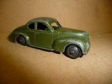 Dinky no.39f Studebaker Commander in dark olive green .Black hubs