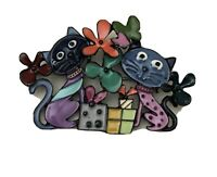Unique  vintage style artistic cat holiday brooch in enamel on metal.