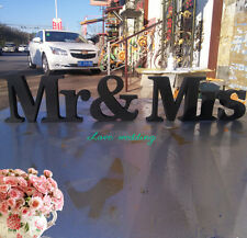 Mr & Mrs wood signs for head table at wedding reception.Mrs & Mr sign for sweet